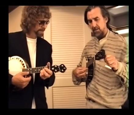 George Harrison and Jeff Lynne jamming on banjo-ukuleles.