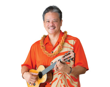 """Gig Bag Tolentino plays a custom Kamaka tenor, named Blue Spruce. It has koa back and sides, spruce top, mother of pearl inlay, an ebony fingerboard. """"I use a low G, set-up with low action so I don't have to play hard, and Savarez classical guitar strings."""" It has an active L.R. Baggs Hex Quad pickup with a volume toggle in the sound hole. """"The Hex has an individual pickup for each string, which gives me an amplified sound that is more balanced and not so percussive."""" He pairs it with an L.R. Baggs Venue DI and also uses a Boss DD-3 Digital Delay, and connects everything with Analysis Plus Silver cables and runs direct. To be prepared for gear troubles at the gig, Tolentino also carries: an extra cable and 9-volt battery, Shure Beta 58 mic, a Pedaltrain Nano pedalboard with a Volto rechargeable battery, Ricola, and Tic Tacs."""