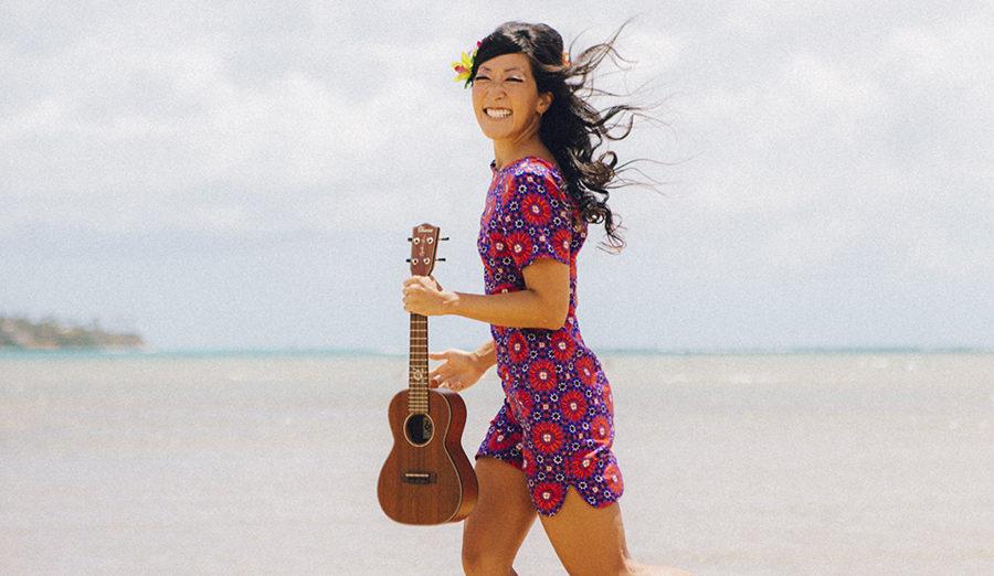 cynthia lin with ukulele on the beach